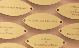Close-up of leaves engraved with names.
